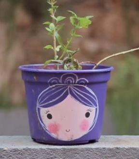 vasos de plantas com carinhas pintadas 07